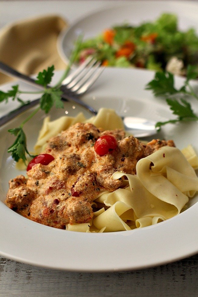Ricotta Pasta Sauce with Italian Sausage, cherry tomatoes over pappardelle pasta