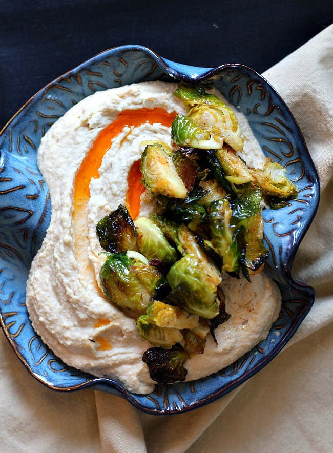 Hummus with roasted brussels sprouts recipe served in a Hilbom bowl