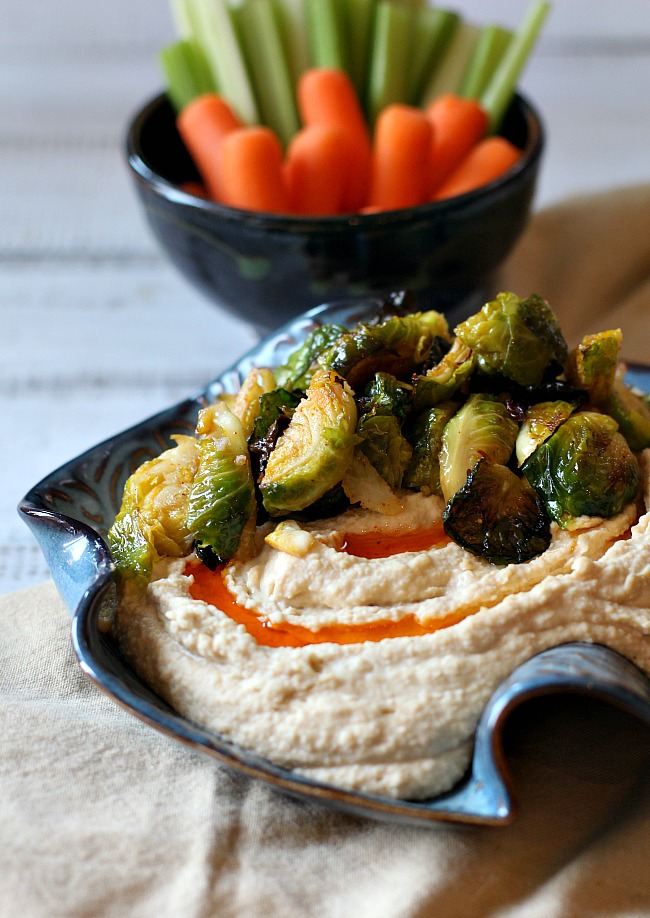Roasted brussels sprouts recipe for hummus with chile oil.