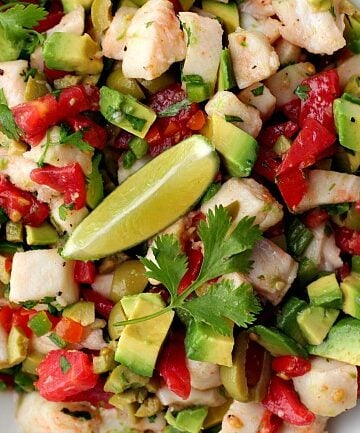 Halibut ceviche with tomatoes, avocado, olives, lime juice