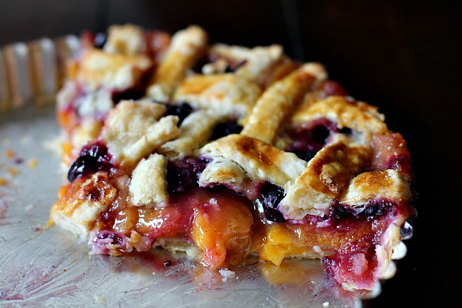 "Peach blueberry pie in a 9"" tart pan with lattice topping."