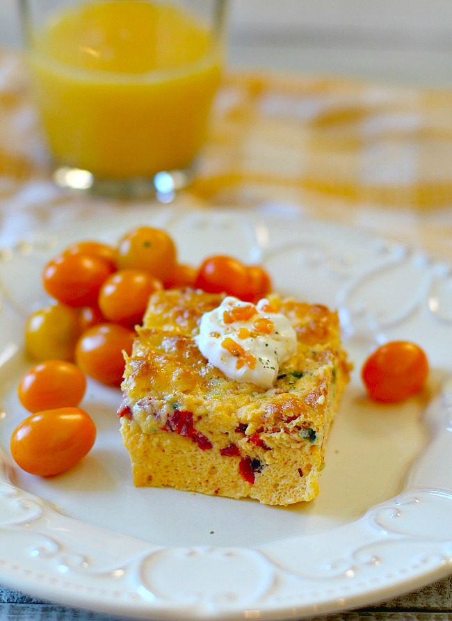 Baked Egg Casserole with heirloom cherry tomatoes topped with sour cream.