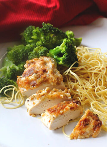 Easy baked chicken parmesan served over spaghetti with steamed broccoli