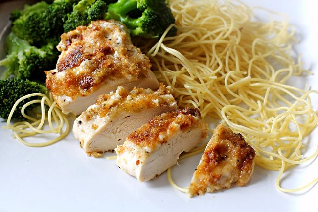 Easy parmesan crusted chicken served with spaghetti and steamed broccoli