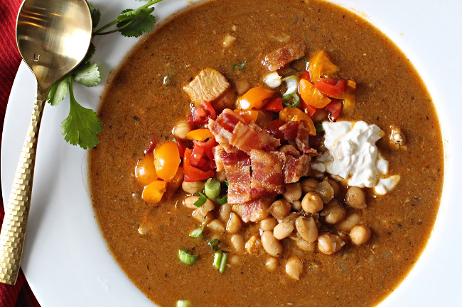 White bean chicken chili with chickpeas tomatoes and bacon