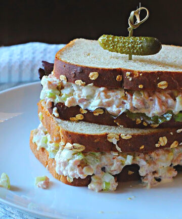 Ham Salad Sandwich Recipe with lettuce on country style bread topped with a pickle.