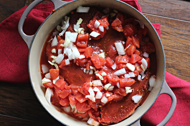 Ingredients for beef street tacos ready to bake in a Le Creuset Pan
