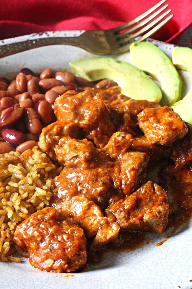 New Mexico Carne Adovada with spanish rice and pinto beans with slices of Avocado
