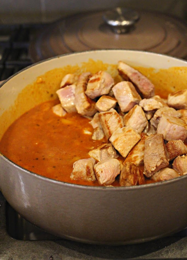 Browned pork loin roast in New Mexico Red Chile Sauce