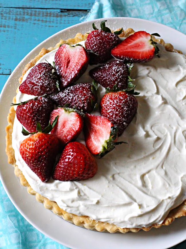 Strawberry Cream Tart with whole halved fresh strawberries