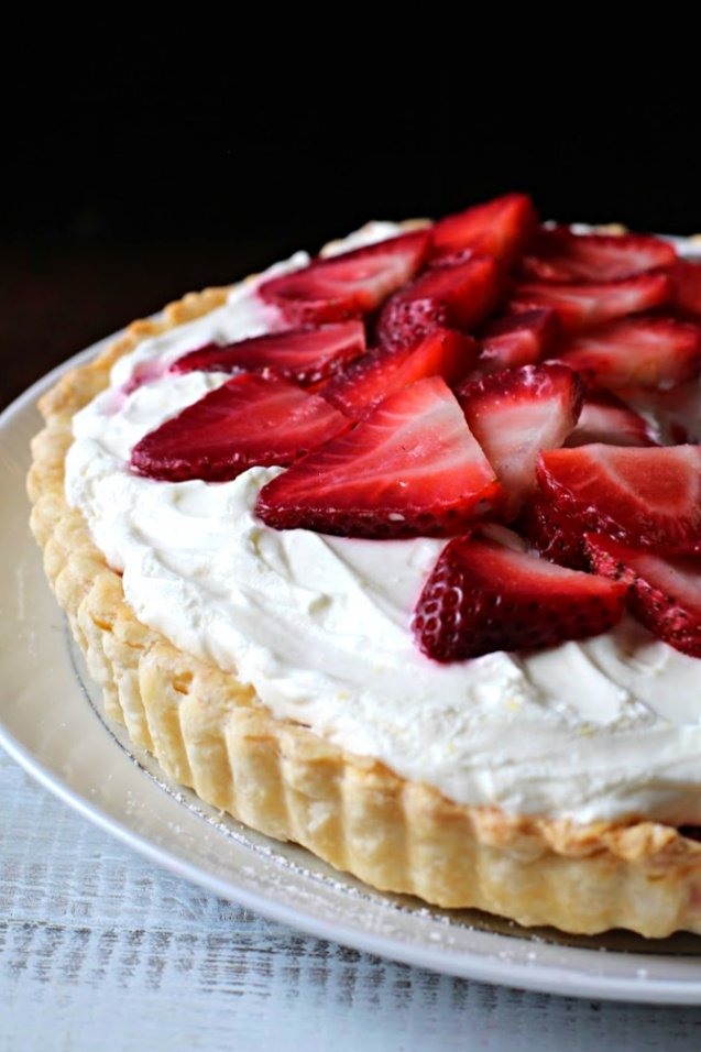Strawberry Dessert Recipe with a tart crust in a tart shell topped with fresh strawberries and whipped cream