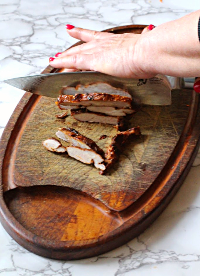 Pork steaks on a cutting board. How to cut pork steaks for tacos al pastor