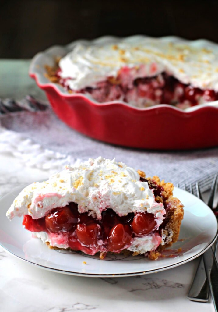 Cream Cheese Cherry Pie Filling Dessert. Served in a sur-la-table pie plate.