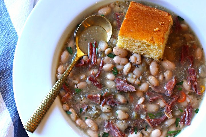 Ham and Bean soup using dried great northern white beans served with homemade corn bread.