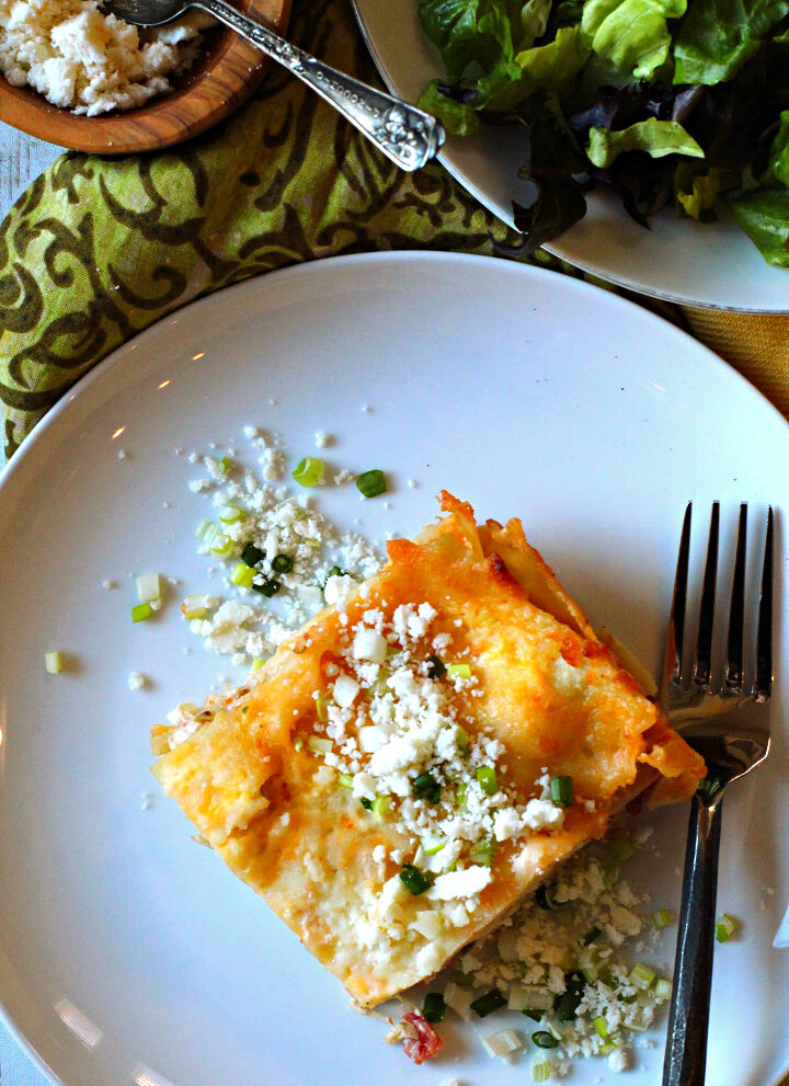 White Chicken Lasagna with green chiles and a creamy white sauce served with a tossed salad and cotija cheese