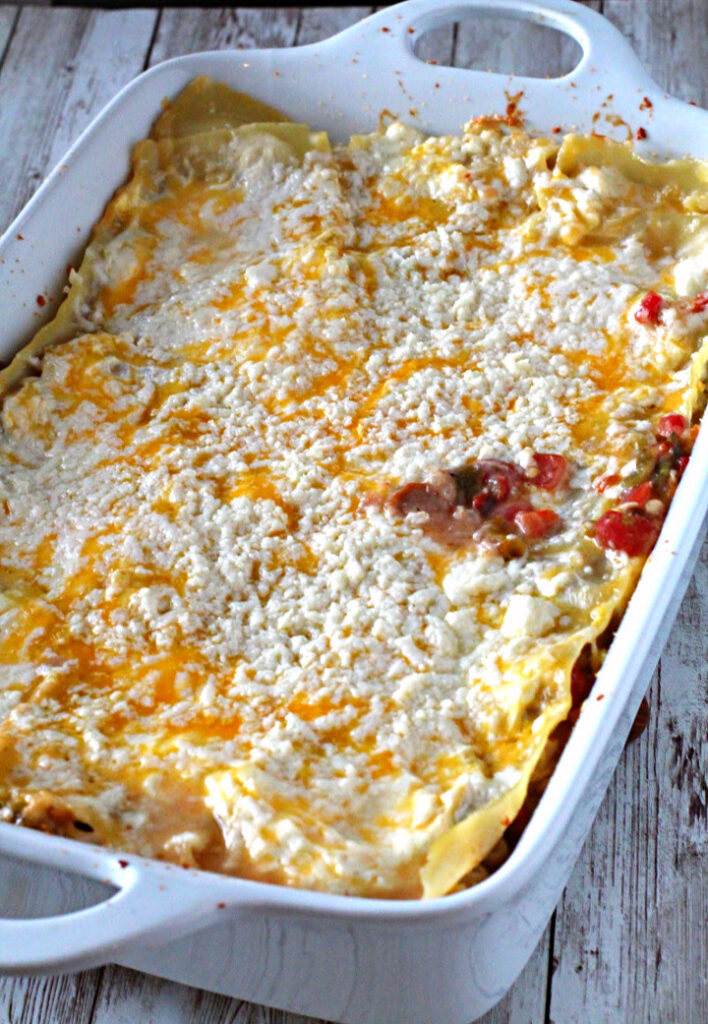 Green Chile White Chicken Lasagna baked in a Le Creuset Lasagna pan and sprinkled with Cotija cheese