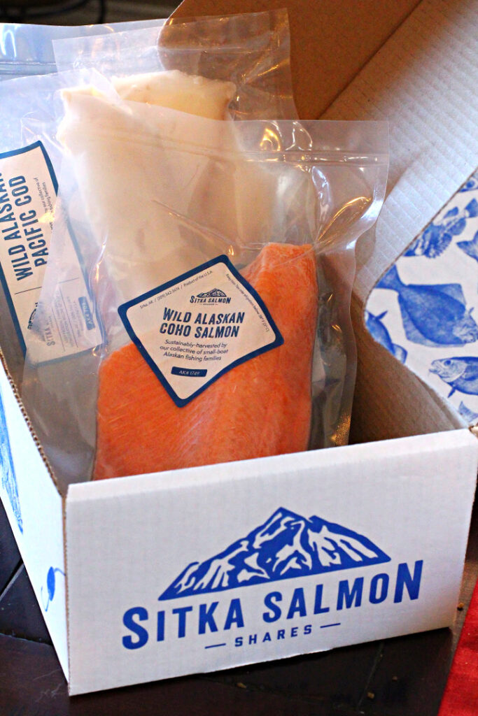 Sitka Salmon a company that will ship fresh Alaskan Seafood to your door. Box Picture of shipping box with frozen Coho Salmon and Cod filletts