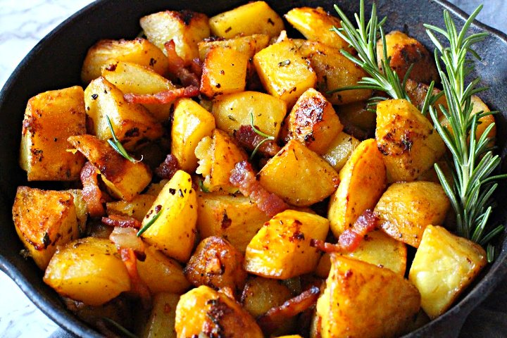 Oven roasted browned yukon gold potatoes cooked in a cast iron skillet