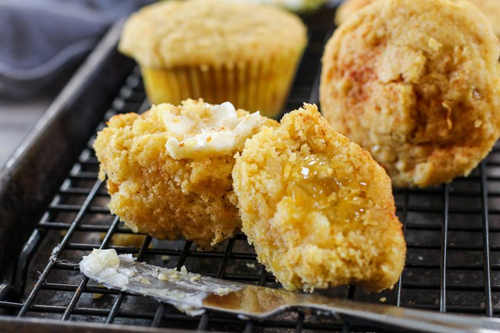 Jalapeno Jelly Corn Bread Muffins cut in half and spread with butter for corn muffins recipe