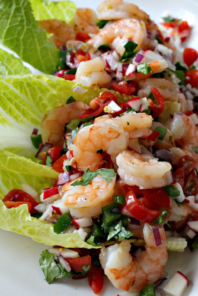 Shrimp and mixed vegetables served on romaine lettuce leaves.
