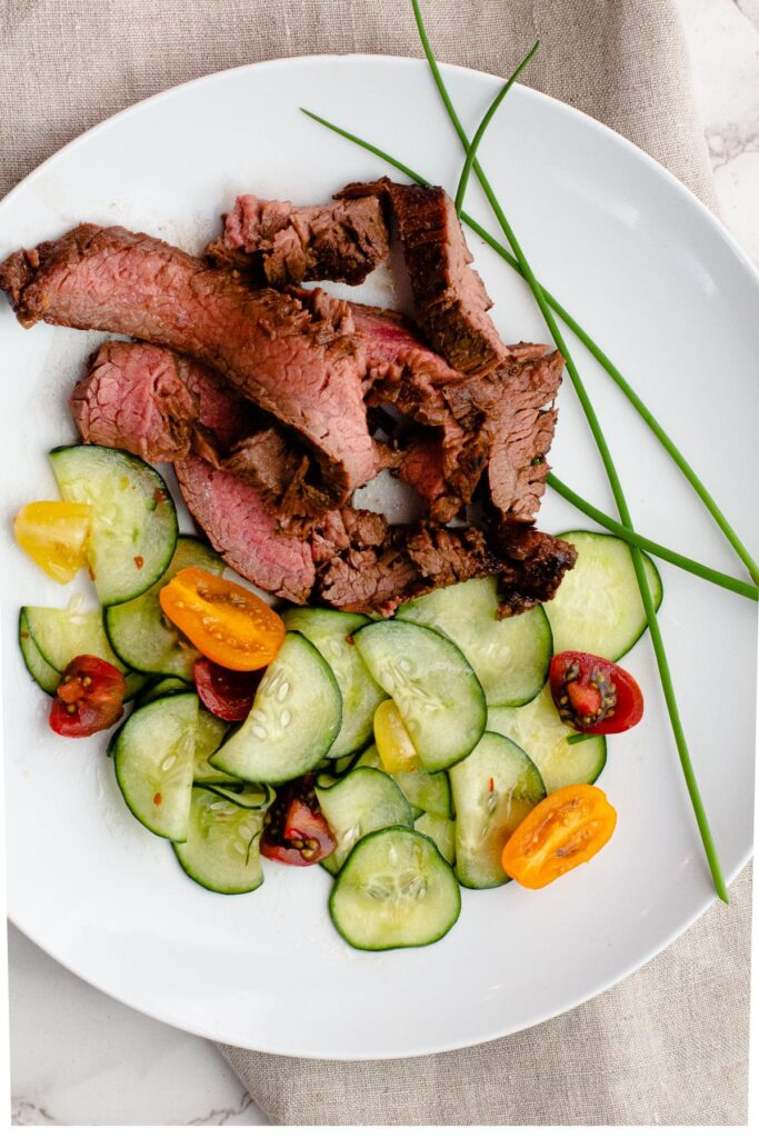 Flank steak marinade recipe with orange and ginger. Served with Asian pickled cucumbers.