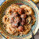 Baked Italian Meatballs in a Colorful pasta bowl with spaghetti and spaghetti sauce