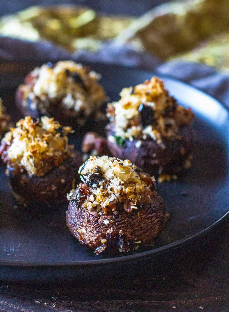 Stuffed mushrooms served on a black plate